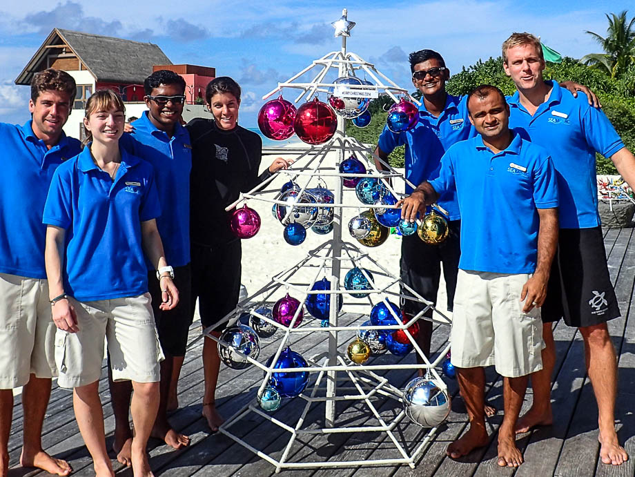 Seamarc staff posing with Reefscapers Xmas tree coral frame [Dec 2014]
