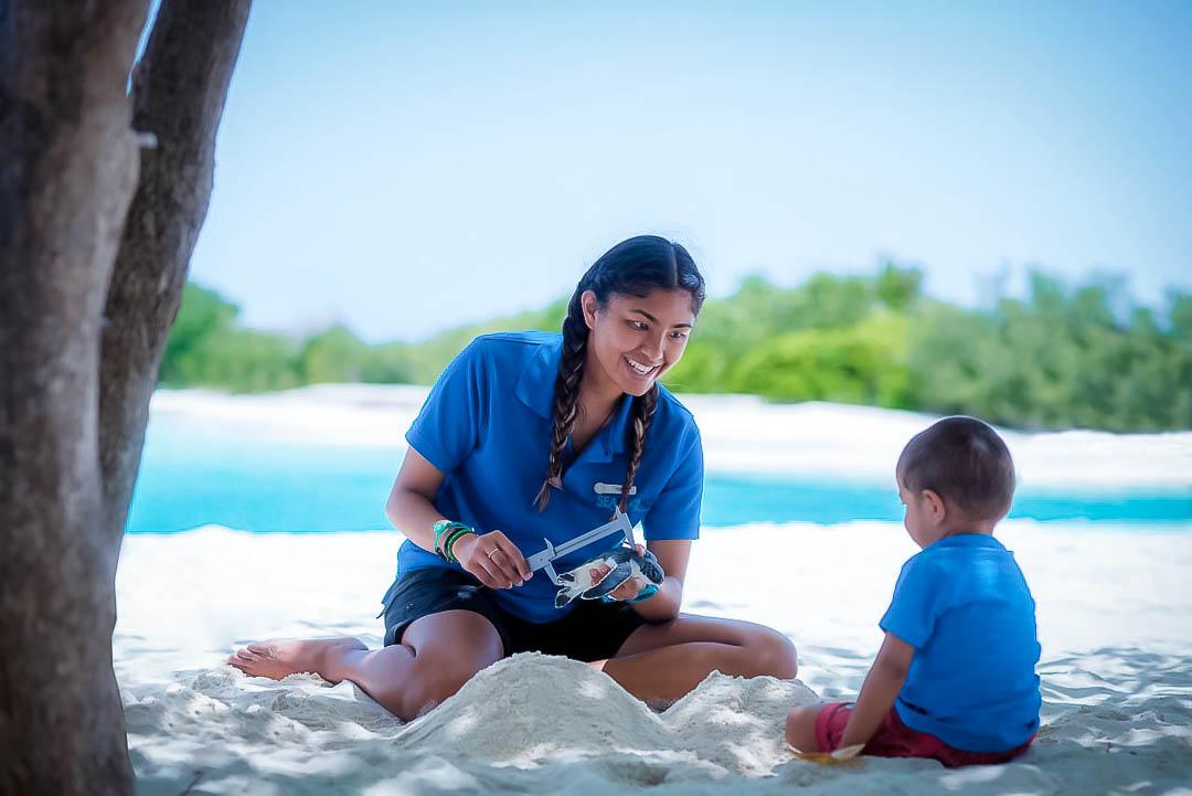 Turtle care - Junior Marine Savers children's activities at Kuda Huraa, Maldives